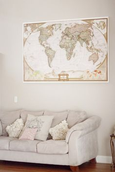 The large world map we acquired on a trip to Seattle – it was love at first sight with this map because of its grand size and neutral shades.
