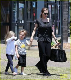 Angelina Jolie takes her twins Knox and Vivienne and her son Pax shopping in Australia on October 27, 2013
