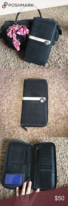 Black coach extra large wallet Wallet is in perfect condition. Only problem which is minor is the ID window has some scuffs as you can see in picture. This is a VERY large wallet. Has tons of pockets and slots and a separate flap for cash. Only the wallet is included. Not the coach purse but the purse is also available in my posh closet!! Just used the purse to show size of wallet. If you are interested in both wallet and the purse I am willing to lower the price on them combined. Just…