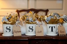 Guests will love this personal touch — gather an initial mug for each guest, and fill them with seasonal candy (like peppermint bark).Photo Credit: Jan Michele Photography