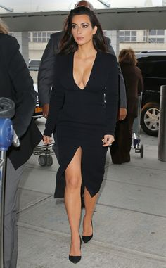 Kim Kardashian shows off her cleavage in a super sexy LBD.