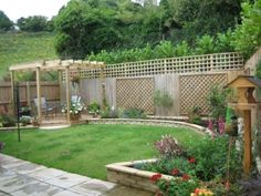 idea for backyard. Stone planter along fence, short deck in corner