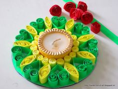 quilled candle frame for Diwali Celebrations ... green hearts and yellow ornamentation ...