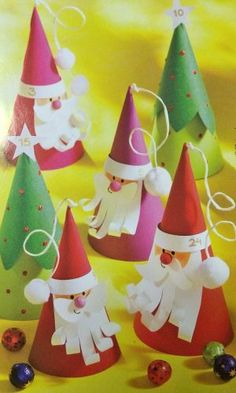 Cute Cone Santas and Christmas Trees from Preschool Activities {Featured in 25 Amazing Santa Claus Christmas Crafts on OneCreativeMommy.com}
