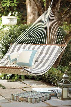 Outdoor hammock with striped cushion Life is a Hammock