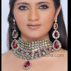 Gold Plated Kundan Necklace Set Accented with Red Stone Price: Usa Dollar $123, British UK Pound £73, Euro91, Canada CA$134 , Indian Rs6642.
