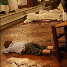 Little boy prostrate priest ordination