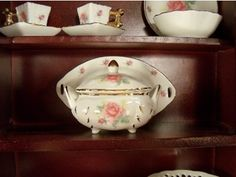 Our fabulous line of mini fine china includes serving pieces like our Soup Tureen for special play time with 18 inch dolls like American Girl Dolls. Designed and exclusively manufactured by us, The Queen's Treasures. The doll accessory 3 piece set includes a platter, soup tureen and lid all in our Pink Rose Pattern. Measures 5 inches wide x 2.5 inches high. Wonderful coordinating mini size tea set, other china serving pieces and Child size tea set sold separately.