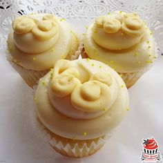The Hippity Hop: coconut cake with fresh lemon curd filling topped with lemon cream cheese frosting and a delicate buttercream swirl. April's Cupcake of the Month!