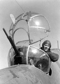 """World War II, in Russia – the Great Patriotic War (22 June 1941 – 9 May 1945). Guards sergeant Mikhail Mikhailovich Badyuk (1920 – 1993), a gunner-radioman of the 9th Guards Torpedo-Bomber wing. He poses in his Il-4 aircraft. Photo by Robert Diament. The Northern Fleet, """"Vaenga-1"""" aerodrome, Murmansk Province, Russia. 1943."""