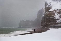 Walker and his dog by Christophe Jacrot | Artistics.com #FineArtPhotography #photo #Normandy #Etretat #sea #waves #snow