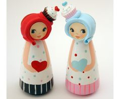 Allie is a beautiful pinkpale blue wooden peg doll