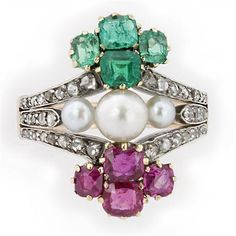 A mid nineteenth century emerald, ruby, diamond and bouton pearl ring (circa 1860)