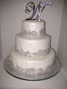 Silver pearls. Definitely a winter wedding cake.