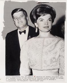 [President John F. Kennedy and First Lady Jacqueline Kennedy attending dinner marking first anniversary of Kennedy's inauguration, District of Columbia Armory, Washington, DC]