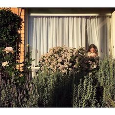 """""""This is part of my Backyard Stories series in #Australia"""" photographer Gabriella Sarnataro (@gabrielladiary) writes. """"This shot captures the only moment my daughter couldn't go outside to play."""" // #contemporaryphotography #documentyourdays #familydocumentary #environmentalportrait #fineartphotography #artphotography"""