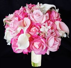 Love this one! Rich bouquet of Pink adn Fuchsia Natural Touch Roses mixed with Off White and Pink Calla lIlies. Crystal Fillers. by www.wedideas.com
