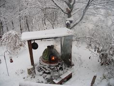 Cob oven fired up during a winter storm.
