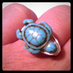 Turquoise Turtle Wrap Ring Handmade wire wrap ring with green turquoise turtle. Sterling silver plated tarnish resistant that holds up to everyday wear. One of kind every wrap ring comes out different every time.LMK what size you would like. Cindylou's Design Jewelry Rings