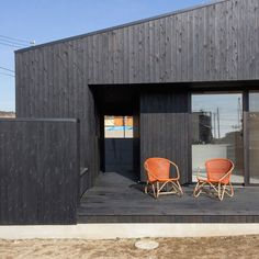 Black-stained cedar clads this weekend house at the beach in Chiba, Japan, by BAKOKO.