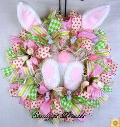 This cute Bunny Booty Ruffled Mesh Wreath is perfect for your Front Door! Made with Cream with Pink, Lavender and Green Wide Foil Stripes done in Ruffle Style. Plush Bunny Booty and Ears (which are bendable). I used 2.5 inch Ribbon Streamers. I added Mini Tulips, Easter Eggs, and