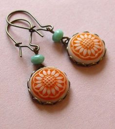 Love these earrings, the color, hooks and smaller but still have interest and a great POP of COLOR