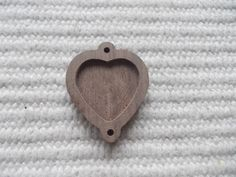 1 p unfinished heart-shaped pendant base with wooden 2 loop,jewel base,blank pendant base/frame,heart resin tray,wooden heart connector 1 piece dark walnut wooden heart-shaped pendant base for jewel or pin making. In the centre of the pendant there is a heart-shaped cabochon frame/hole, which gives a more attractive look to the pendant.  https://www.etsy.com/listing/220203563/new-1-p-unfinished-heart-shaped-pendant?ref=related-4
