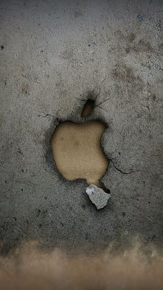 Apple logo carved into the ground and then dug out I think