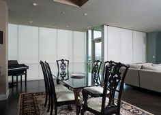 Solar shades produce a simple and streamlined appearance fit for any décor. #BudgetBlinds