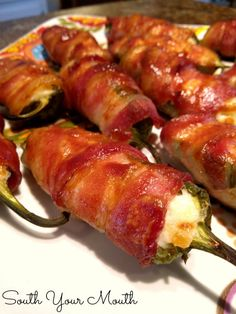 Bacon-Wrapped Pineapple Jalapeno Poppers - Jalapeno peppers stuffed with pineapple and cream cheese, wrapped in bacon and basted in barbeque sauce. STOP IT!!! Get in mah belly!!!