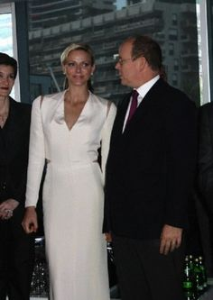 Prince Albert of Monaco with his wife Charlene, Princess of Monaco attends the opening of the luxury club in Monaco on 12 May 2013