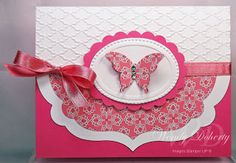 handmade card ... just two colors ... rosey red and white ... luv the formal, balanced layout and the half label sticking out ... embossed texture ... punched butterfly ... Stampin' Up!