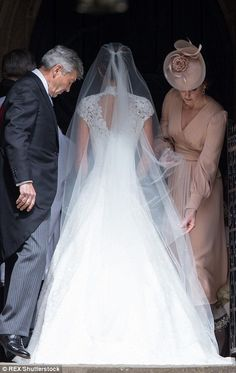 The Duchess of Cambridge could be seen tentatively rearranging Pippa's veil which was stud...