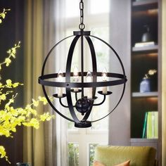 The Kandace is an oil rubbed bronze globe pendant. Four candle style lights in a single tier interconnected to a small globe below give this piece an old world feel. Add this to a contemporary room or any other style to get a great mix of old and new.