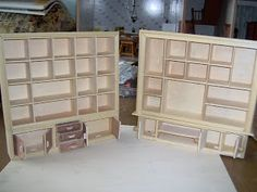 Shelf units from mini display cases (take off clear lid); drawers from lids of mini cases; cases become larger storage sections underneath shelves; keep hinges for other projects