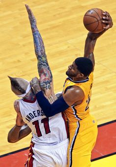 TATTOO YOU Indiana Pacers Paul George aims at the basket as Miami Heat power forward Chris Andersen (11) during the second half of Game 2 in their NBA basketball Eastern Conference finals playoff series, Friday, May 24, 2013 in Miami. (AP Photo/Alan Diaz) MORE NBA PLAYOFF PHOTOS HERE