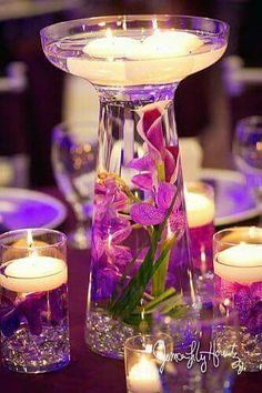 Purple wedding! Purple flowers and purple decoration candles with purple beads! Love this~Purple everything!!