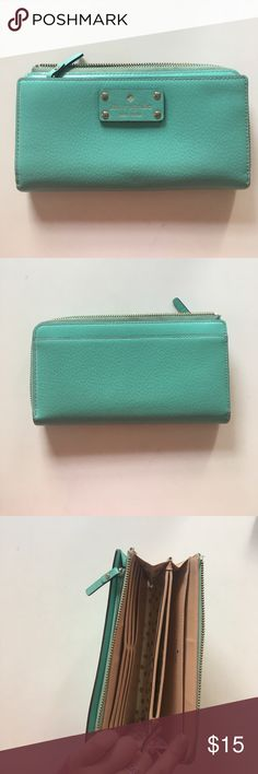 Kate Spade light blue leather wallet Beautiful wallet, however well used. One of the zippers is actually missing but it could be easily replaced! Selling for low price because of missing zipper but its still a pretty kate spade wallet (-: kate spade Bags Wallets