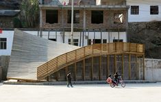 The Pinch Library And Community Center / John Lin Olivier Ottevaere Completed in 2014 in China. THE PINCH is a library and community center in Shuanghe Village Yunnan Province China. The project is part of a government led reconstruction. World Architecture Festival, Space Architecture, Temporary Architecture, Community Library, Modern Library, Library Design, Beach Shack, Urban Design, Playground