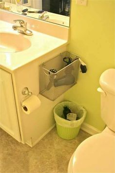 Hairdryer holder.  Instead of a wire basket, use a solid box of the same shape and cover it with the same wallpaper used on the bathroom shelves.