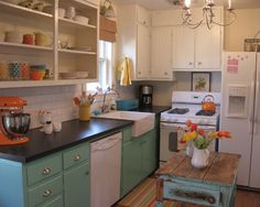 Easily a do-able kitchen on a lower budget if you have a collection of odds and ends you've inherited from friends & family.  This kitchen is super cute! Looks like you'd need just a little paint and some flowers to match :)
