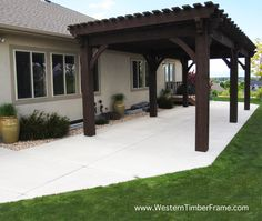 a 14x31 solid wood over sized timber frame pergola from western timber frame using old world