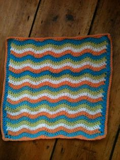 A blanket for a dolly, made with leftover wool from Martha's blanket.