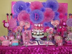 Pop star themed candy/dessert table designed by Glam Candy Buffets for a ten year old girl's birthday party. Custom made fan backdrop by Glam Candy Buffets.