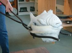 The fish are fired in bisqued firing cradles and specially-designed tongs are used to easily remove them from the kiln for post-firing reduc...
