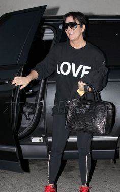 Kris Jenner in I am LOVE tee. Get the look! http://peaceloveworld.com/index.php/just-love-pima-black-hoodie-tee-PDPA.html