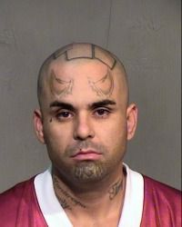 "Moses Ulloa tattoos include the City of Glendale logo on the top of his head, ""Murdercopa County"" on his neck, horns on his forehead, and a bullet hole between the words ""bullet proof"" on the side of his head -- lined up for Ulloa's third mugshot at the Maricopa County Jail in four months."