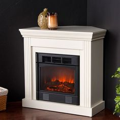 Providing all the style and class of a full-sized fireplace in a conveniently compact size, the Wexford Petite Convertible Ivory Black Electric Fireplace. White Corner Electric Fireplace, Corner Gas Fireplace, Fireplace Heater, Faux Fireplace, Fireplace Inserts, Fireplace Design, Fireplace Mantels, Fireplace Ideas, Propane Fireplace