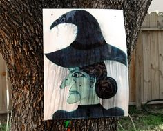 Wizard of Oz party games- Melt the Witch. A painting of the Witch using Tempra Paint, kids throw water balloons at her face to melt the paint off the picture. So cute!