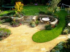 20 Ways to Make a Small Garden Seem Bigger - Separate Lawn from Seating with Wall and Plants